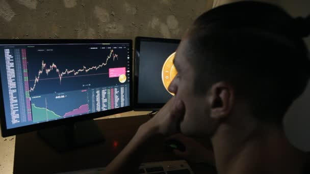 Man earns bitcoins on the financial market on computer