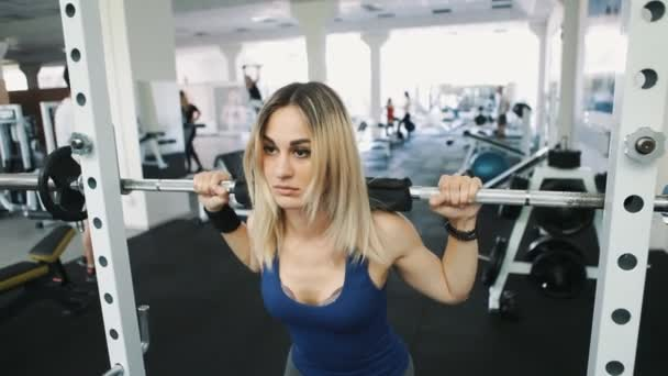 sexy girl with sexy body doing barbell workout routine in gym, healthy lifestyle