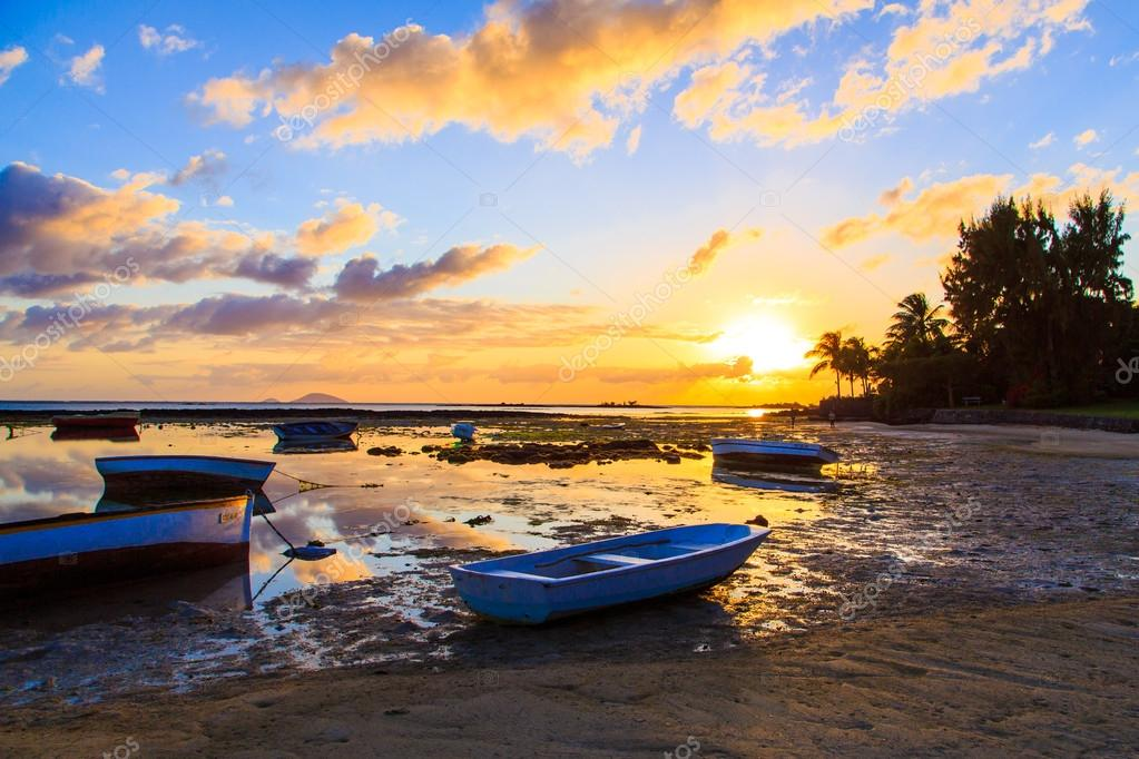 Old fishing boat at the sunrise on Mauritius island
