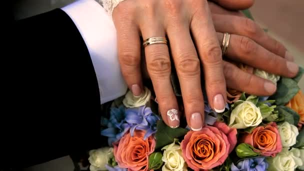 bridal bouquet and wedding rings