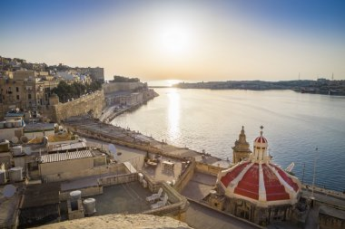 Valletta, Malta - Panoramic skyline view of the ancient walls and houses of Valletta at sunrise
