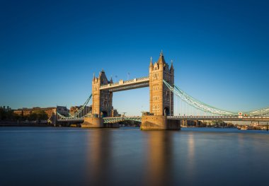 The iconic Tower Bridge at sunset with clear blue sky, London, UK