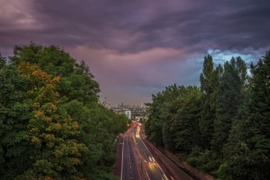 Skyline of central London with storm clouds from Holloway Bridge, UK