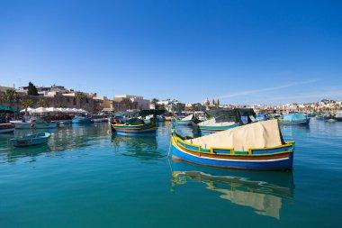 Typical colorful fishing boats near Marsaxlokk market, Malta