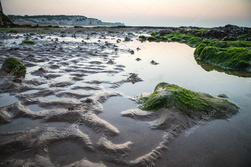 British beach at low tide after sunset, England, UK