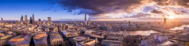Panoramic skyline of south and east London at sunset with beautiful clouds.