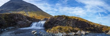 Panoramic shot about the Fairy Pools and the mountains of Glenbrittle at early morning on Isle of Skye - Scotland, UK