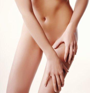 woman with slim body massage with moisturizing cream