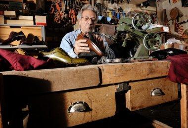 craftsman making luxury handmade man shoes