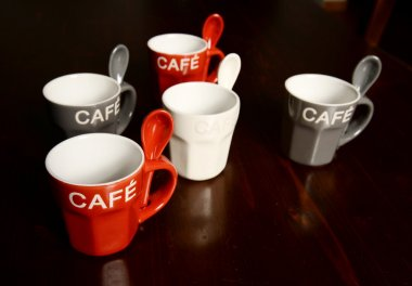 Colored Coffee cups on wooden table