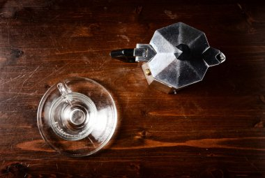 glass  coffee cup and  vintage coffeepot on dark wooden table