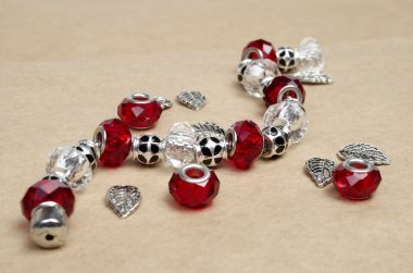 Modern fashion jewellery with charms and pendants on craft background