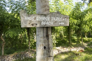 Wood sign.  Path to Anse Source d Argent beach, la Digue, Seychelles.