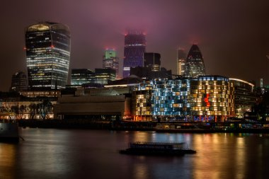 Modern city of London at night