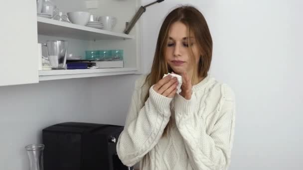 Sick girl blowing her nose