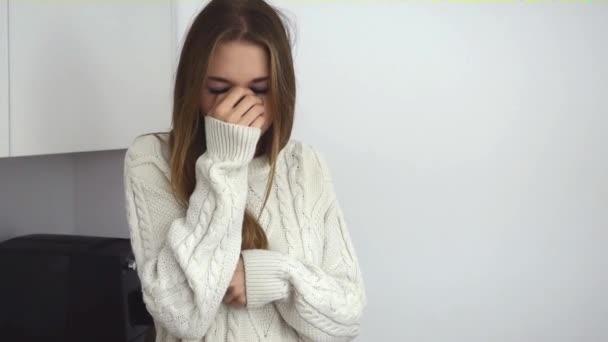 Sick young girl having chills