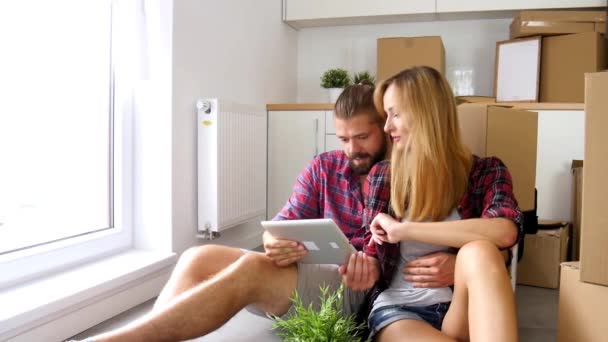 couple sitting on the floor with tablet pc