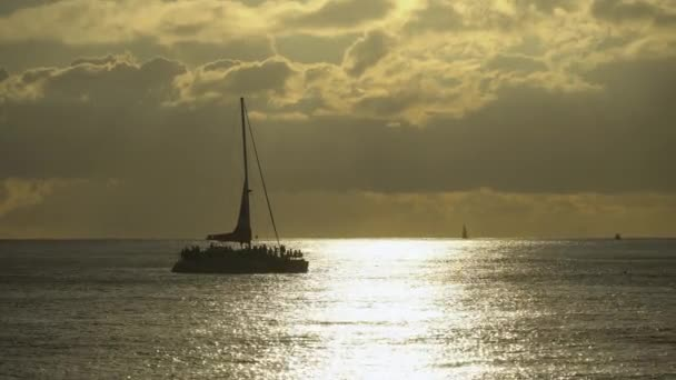 Amazing colors of tropical sunset. Sail boats silhouettes floating on ocean horizon. Oahu island, Hawaii summer vacation.