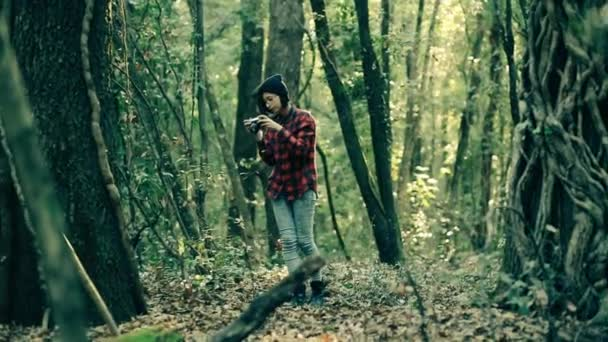girl taking photo in the forest