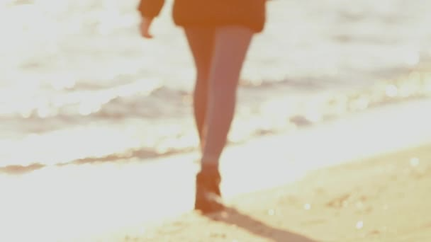 Girl running on the beach. Shot in slow motion