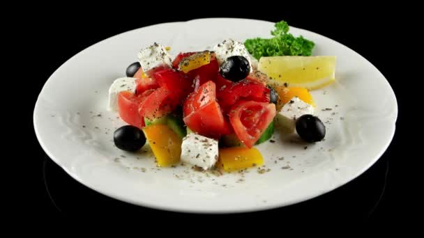 Organic salad with fresh vegetables and feta cheese, loop, horizontal view