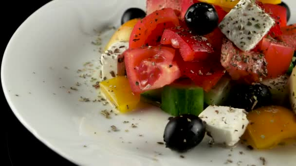 Greek salad with feta, tomatoes and black olives, loop