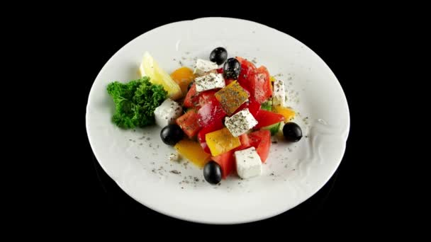 Fresh classic Greek salad (vegetables and feta cheese), loop, top view