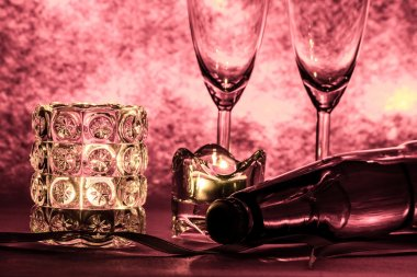 Cool Champagne and glass prepare for Celebration. Candle is ligh