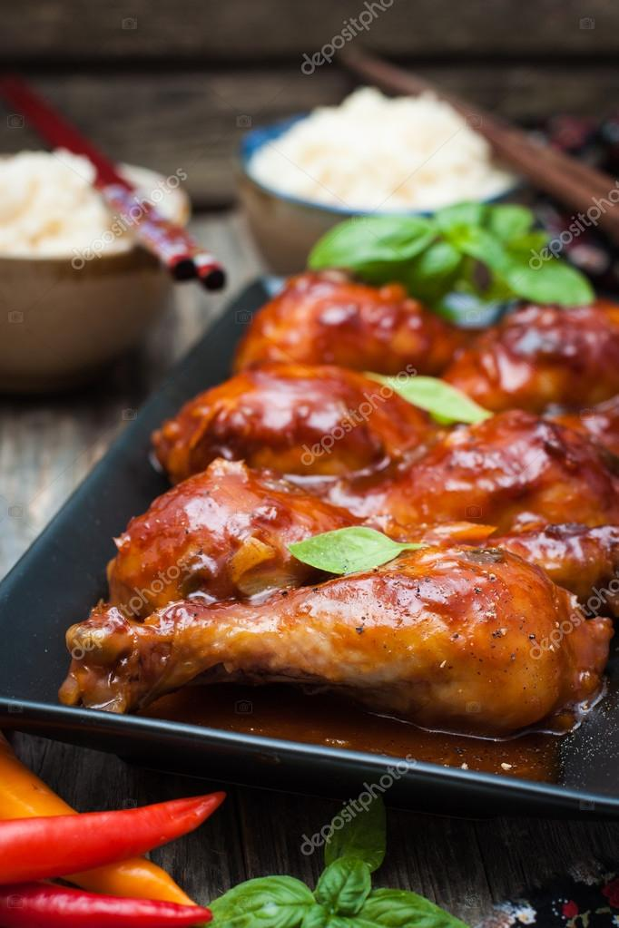Chicken drumsticks in a sweet and sour sauce