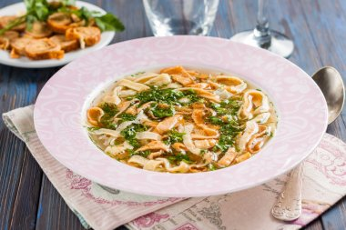 Soup with egg pancakes and herbs