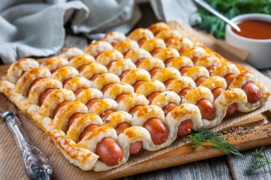 Sausages in the dough with ketchup