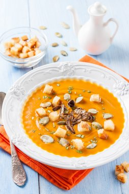 Autumn pumpkin soup with porcini mushrooms