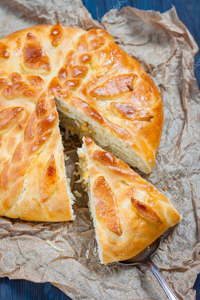 Yeast cake with filling - stewed cabbage with egg.
