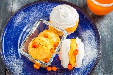 meringue with ice cream of sea buckthorn