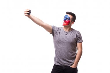 Selfie on phone of Czech football fan in game supporting of Czech Republic national team on white background.