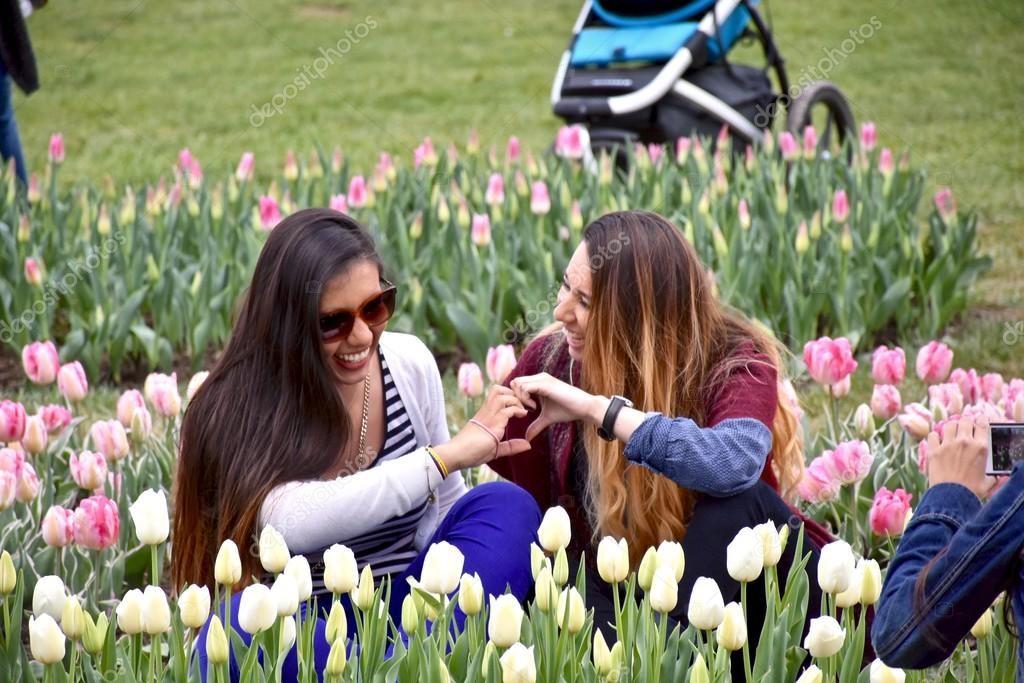 Two Girls Posing Or Pictures In A Flower Garden U2014 Stock Photo