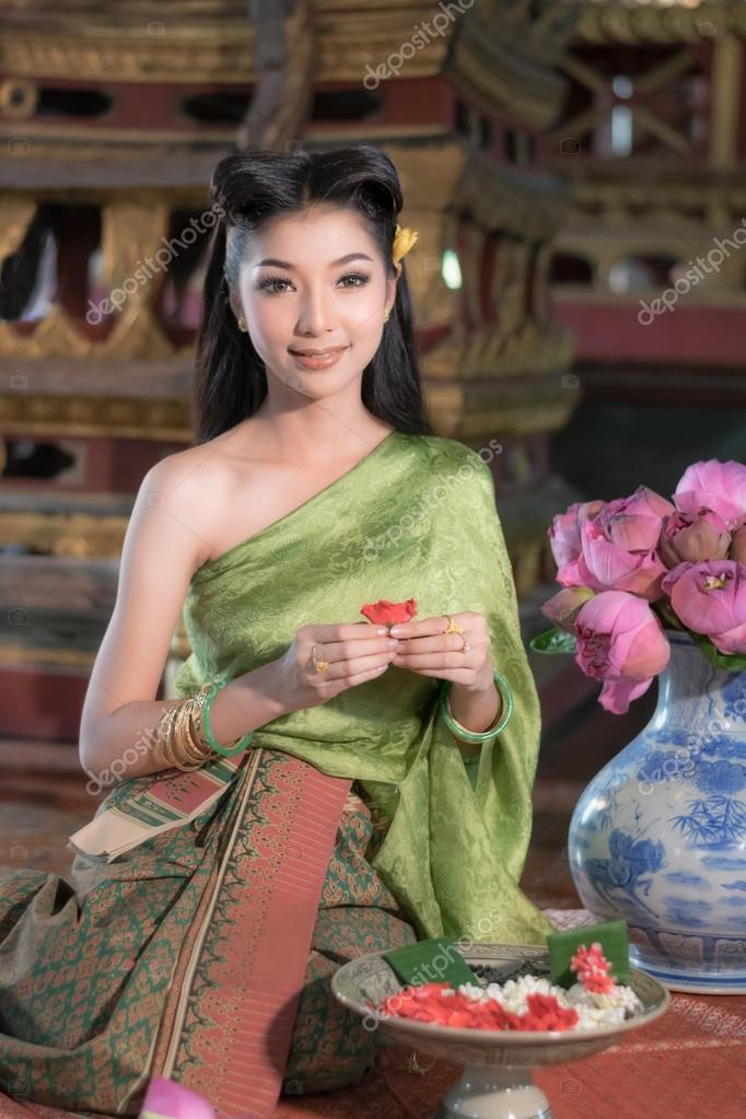 Women In Thai Traditional Dress At The Old Temple Ayutthaya Stock Photo