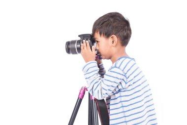 cute little boy taking camera