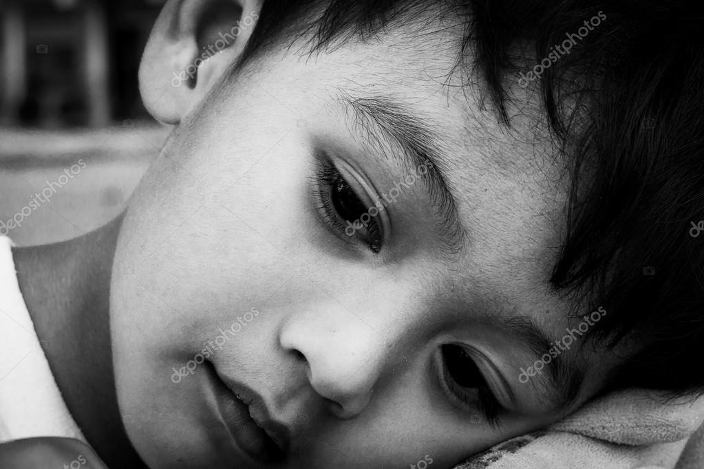 Face cute little boy sad alone ,black and white tone — Stock Photo