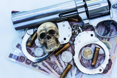 skull human with handcuff and revolver,bullet .375 on money bac