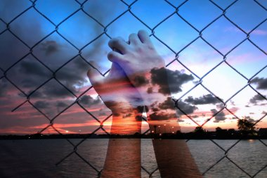 double exposure of asian girl hand hold jail on sunset at the se
