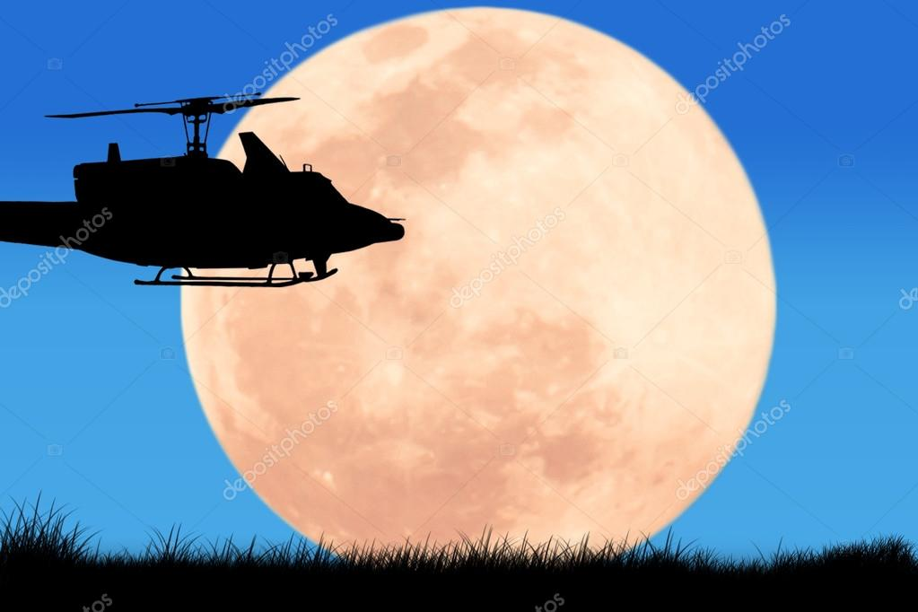 silhouette  of  helicopter on the sky night full moon background