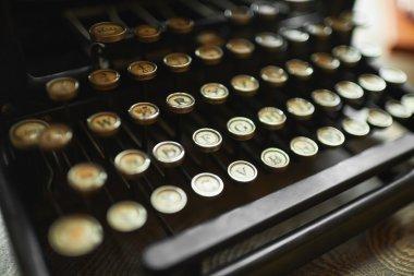 Close up photo of antique typewriter keys, shallow focus