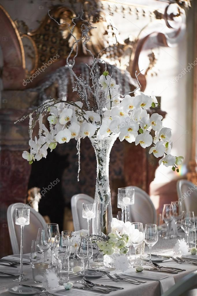 Wedding Reception With Floral Arrangement Of White Orchids Stock