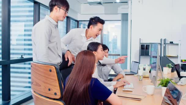 Group of Asian business people work together in team brainstorm discussion, clap hand celebrate in office. Corporate business, coworker teamwork, or success project meeting concept