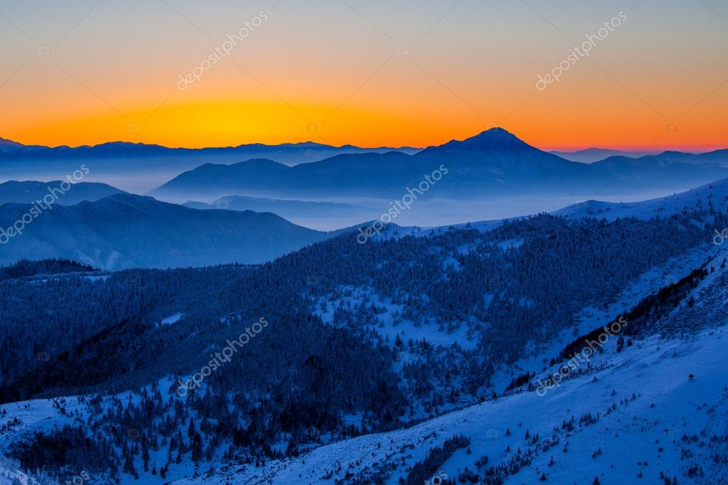 Glowing winter sunrise in the mountains