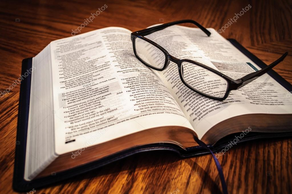 Open Bible Study book on table  with Glasses