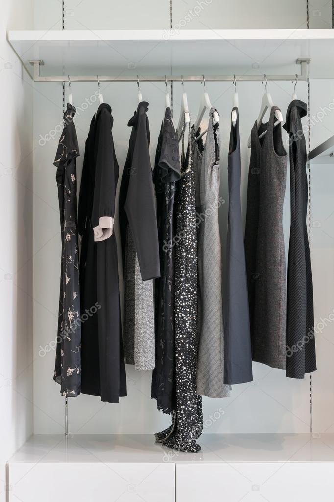 Modern Closet With Row Of Black Dress Hanging On Coat Hanger In Wardrobe. U2014  Stock