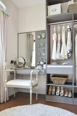vintage style dressing room with classic white chair and dressing table