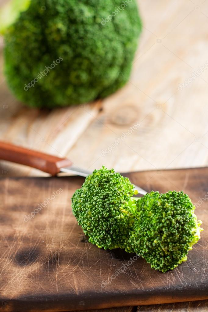 Raw fresh broccoli on wooden background.
